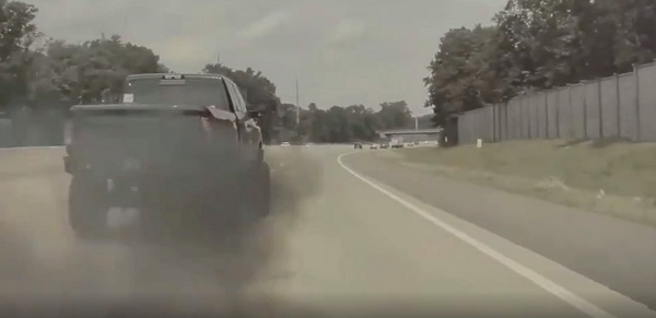 image-of-Truck-Driver-Deliberately-Rolls-Coal-And-Blocks-A-Tesla